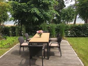 Garten und Terrasse direkt am Strand/Promenade