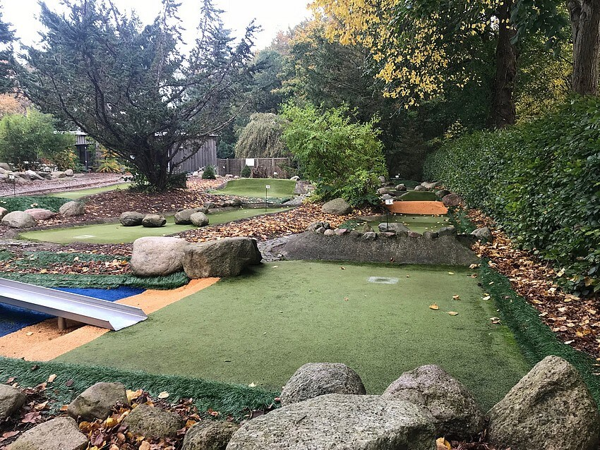 Look through the paths of the mini golf course